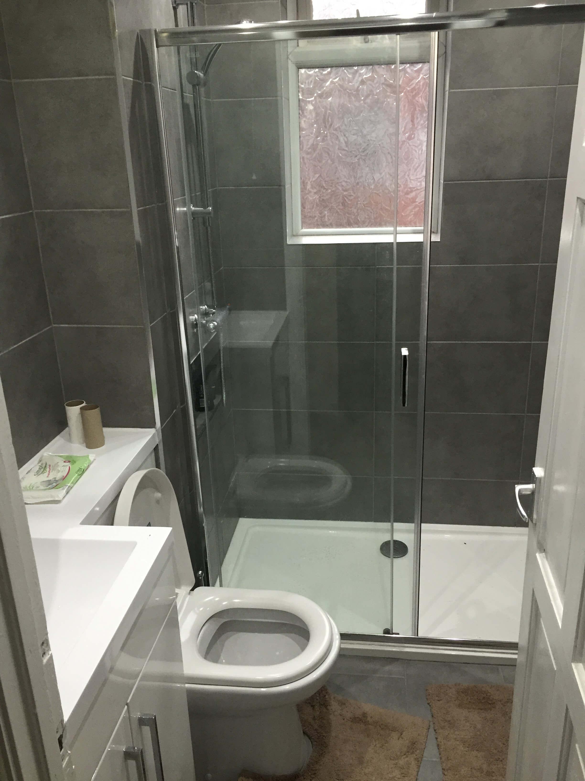 Dark grey tiled bathroom