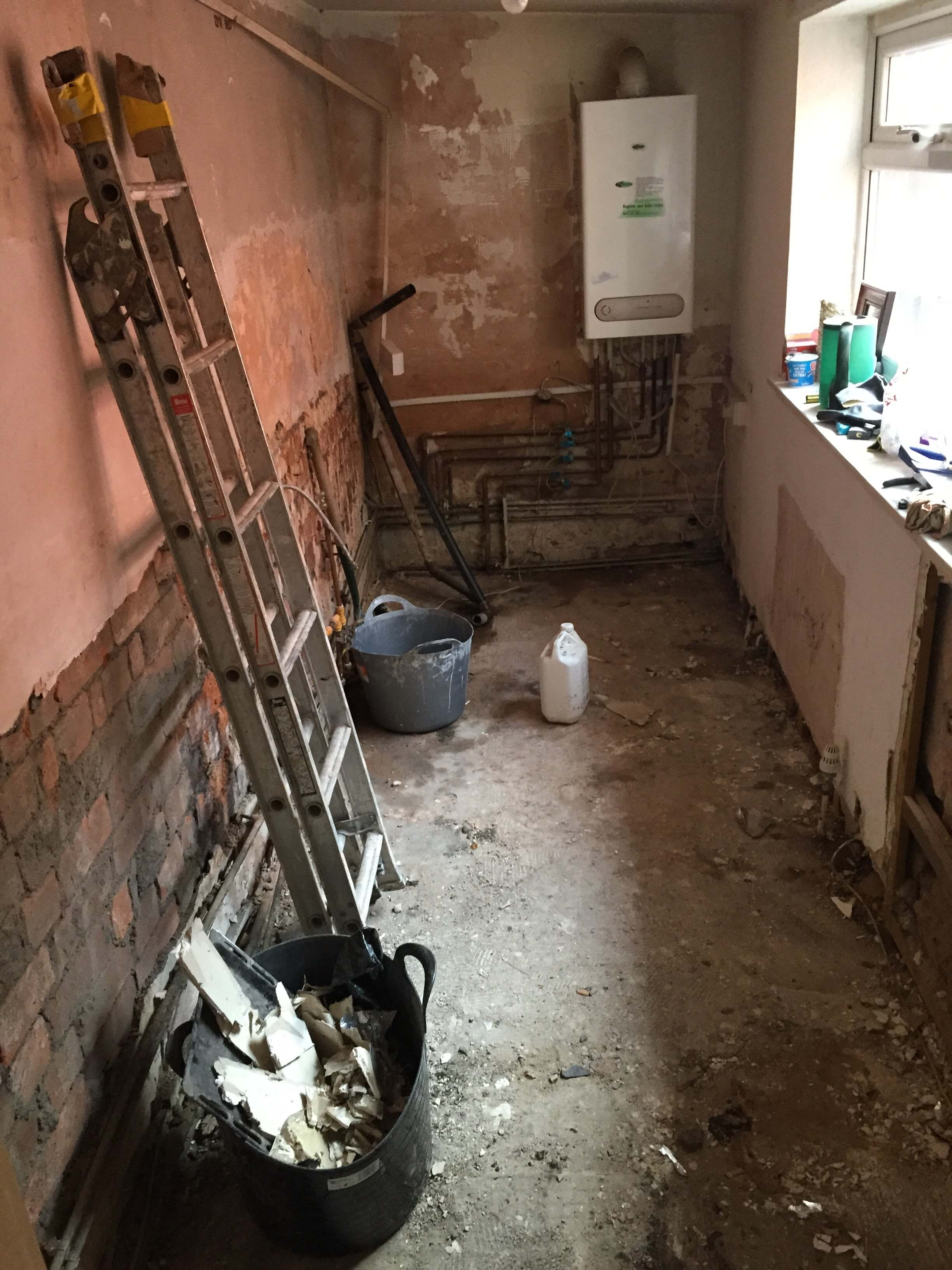Before - Kitchen without flooring, plastered walls or equipment